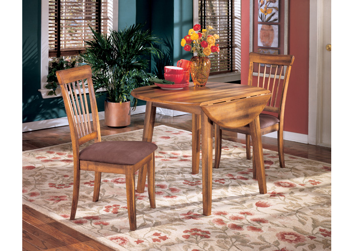 Berringer Round Drop Leaf Table W 2 Chairs Ashley Furniture Homestore Independently Owned And Operated By Dash Square