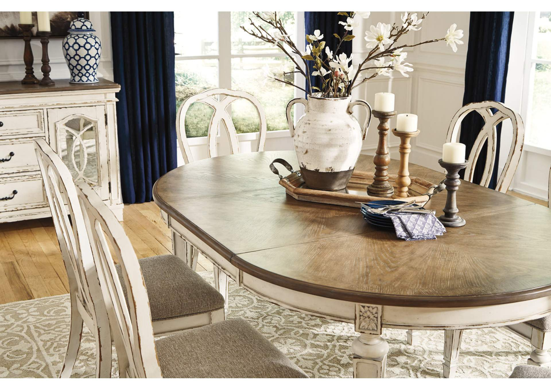 Realyn Dining Room Extension Table Ashley Furniture Homestore Independently Owned And Operated By Hamad M Al Rugaib Sons Trading Co