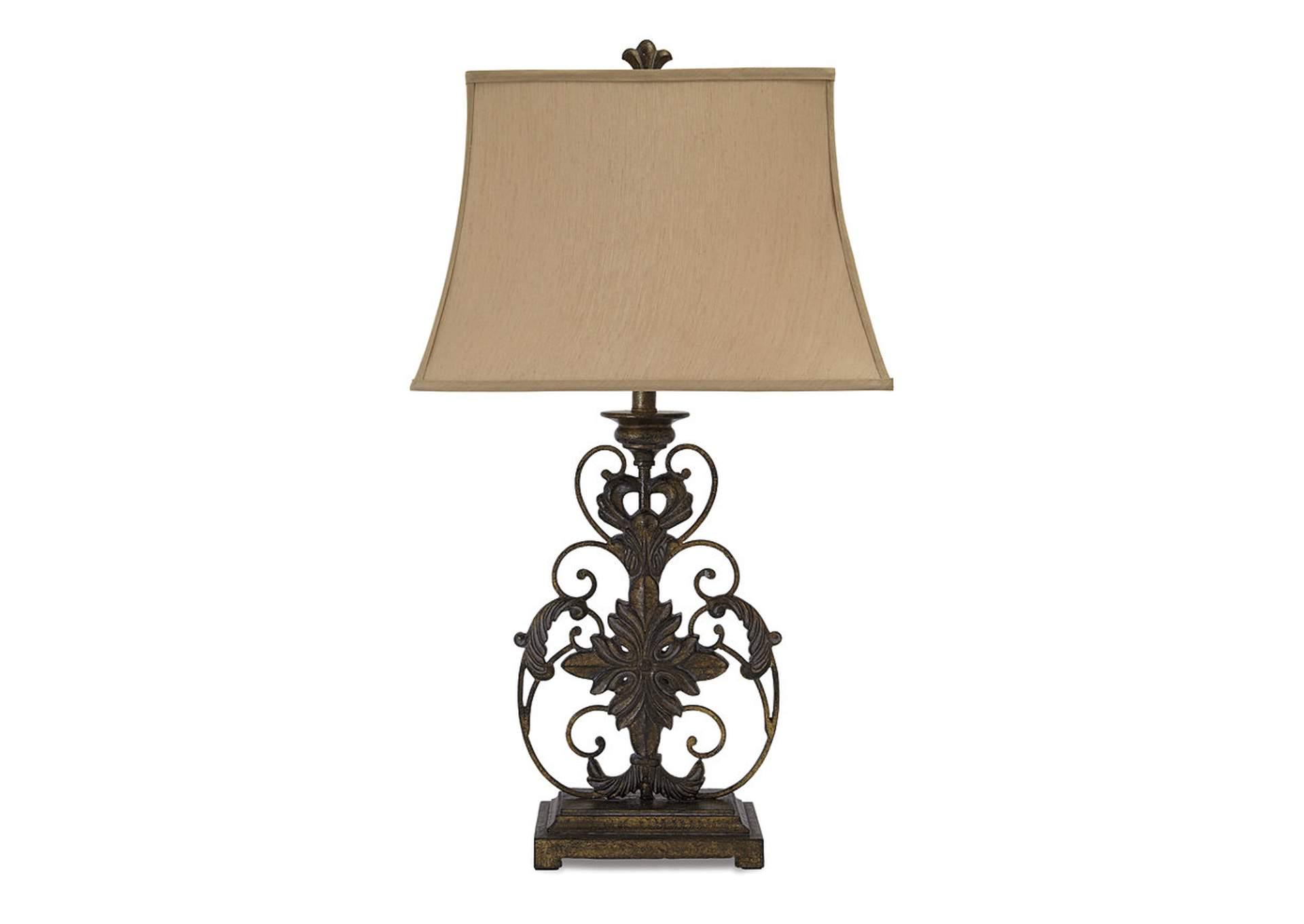 Lámpara de mesa de metal con acabado dorado